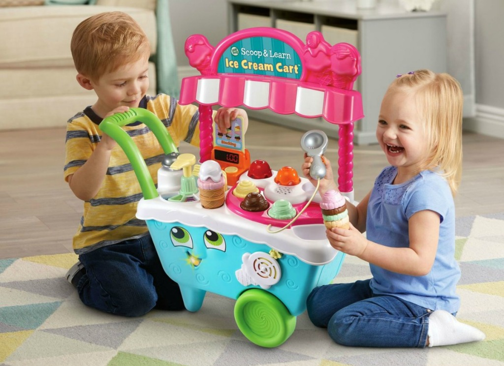 kids playin g on the floor with the LeapFrog scoop & learn ice cream cart