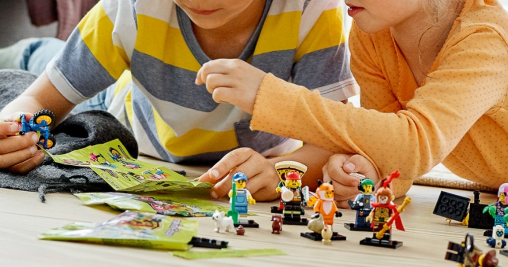 Kids playing on floor with LEGO Series 19 Minifigures Blind Bags
