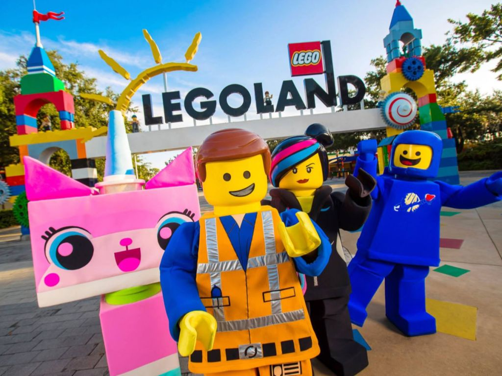 legoland sign with characters in front of it such as unikitty, emmett