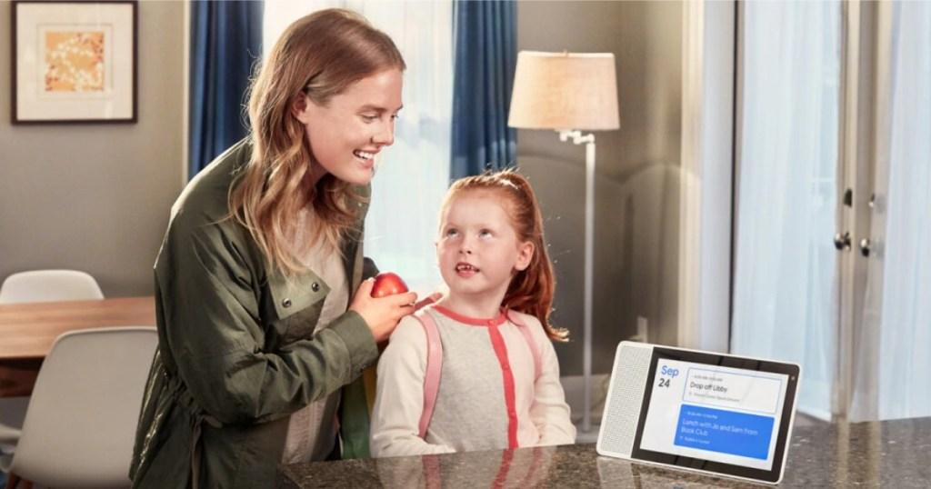 woman and daughter using Lenovo Smart Display as calendar