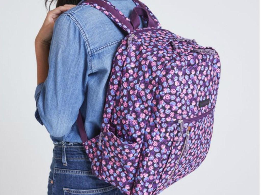 girl wearing Lighten Up Backpack