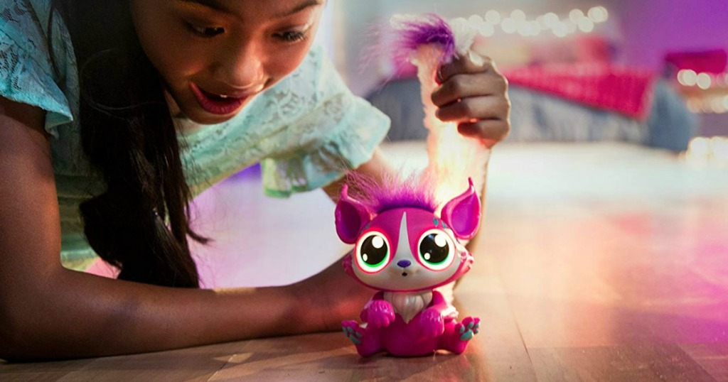 Girl playing with Lil Gleemerz Adorbrite
