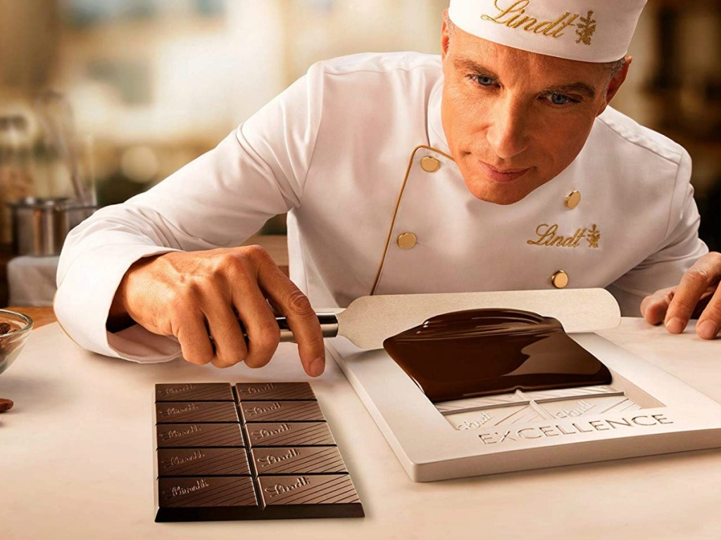 man making Lindt Chocolate Bars