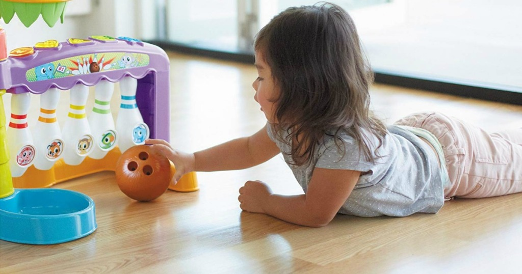 toddler girl bowling with Little Tikes 3-in-1 Sports Zone
