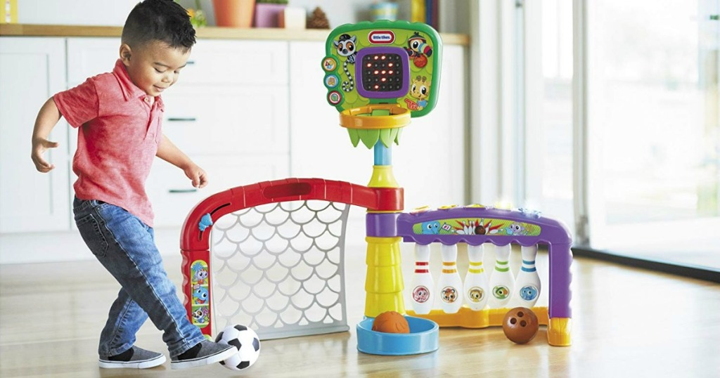 toddler boy playing with Little Tikes 3-in-1 Sports Zone