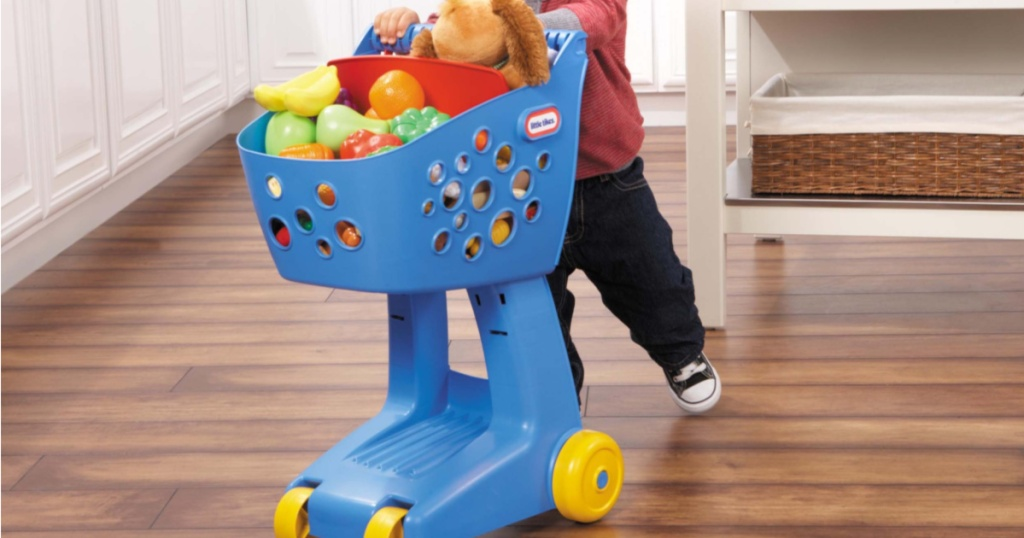 kid playing with blue little tikes lil shopper