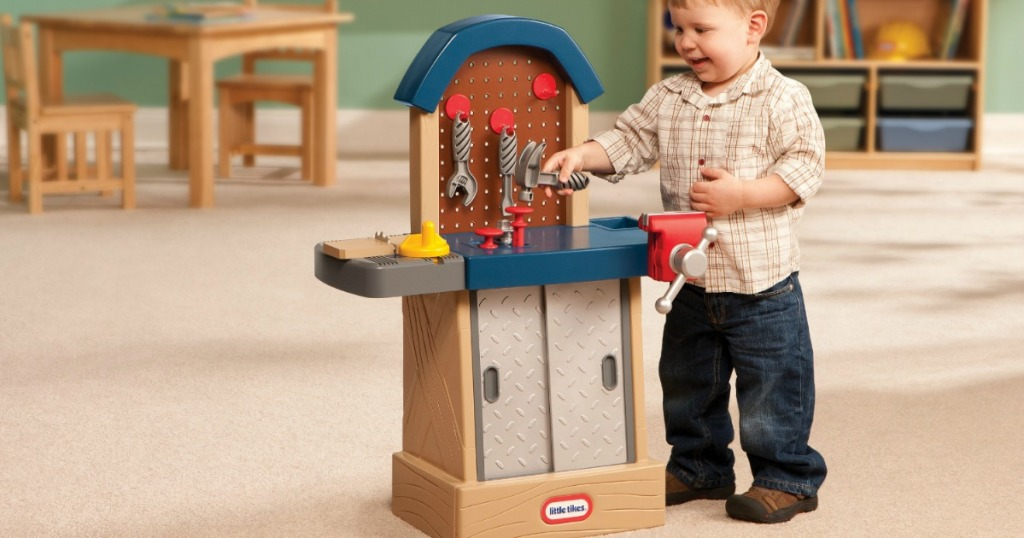 toddler playing with Little Tikes Tough Workshop