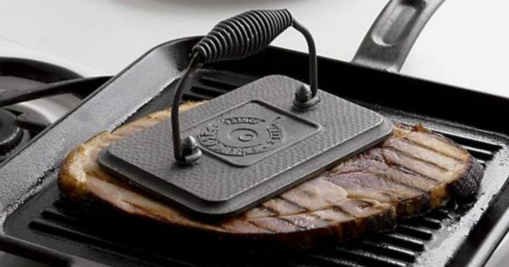 Lodge Rectangular Cast Iron Grill Press on steak
