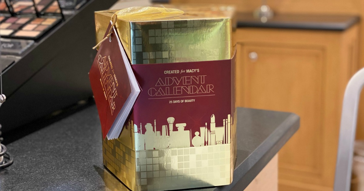 Macy's beauty advent calendar in gold box sitting on counter