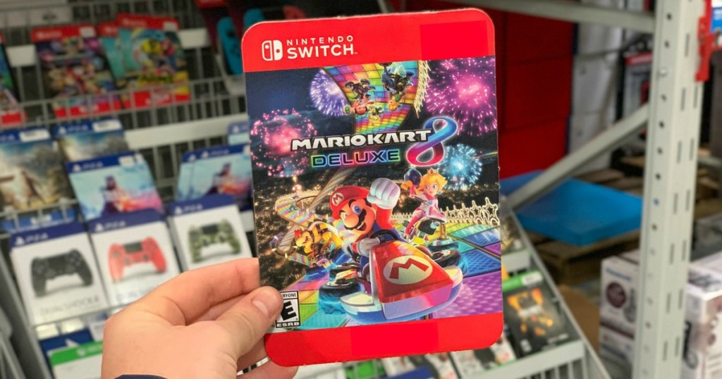 Mario Kart 8 Deluxe Game Nintendo Switch being held by a mans hand