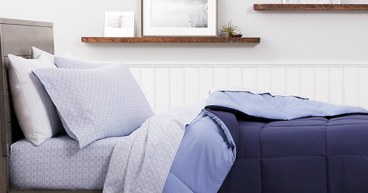 bed with navy blue sheets & bedding