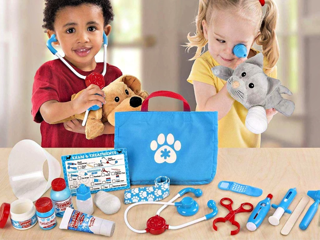 Melissa & Doug Examine And Treat Pet Vet Play Set with kids