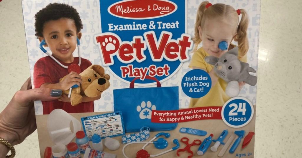 hand holding Melissa & Doug Pet Vet Set