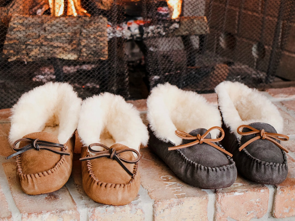 Men's Moccasin Slipper pairs in front of fire place