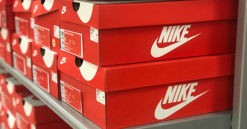Stack on Nike brand shoe boxes on store shelf at Kohl's