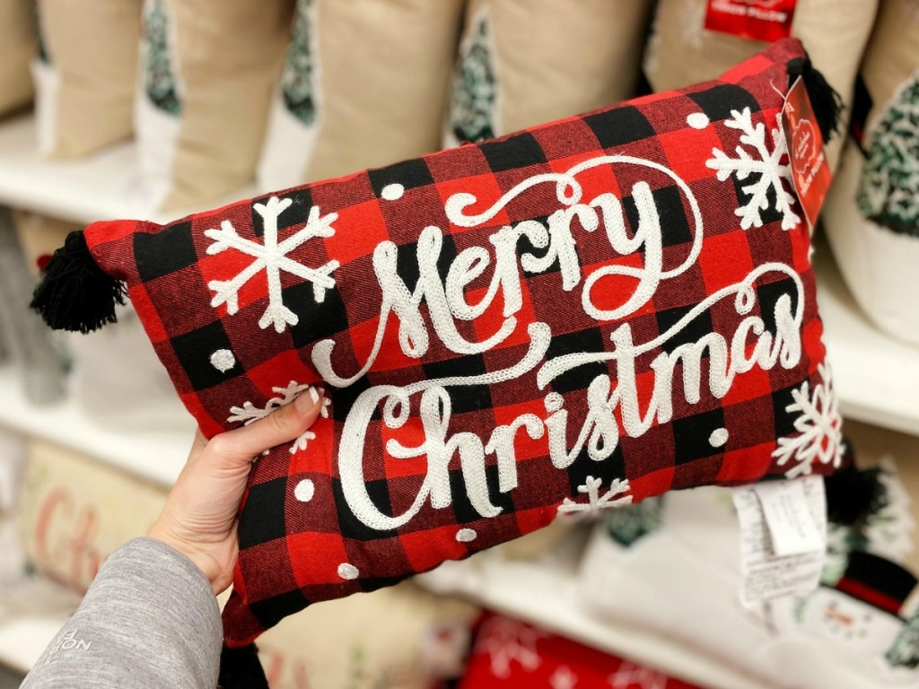 Merry Christmas throw pillow in hand in Kohl's