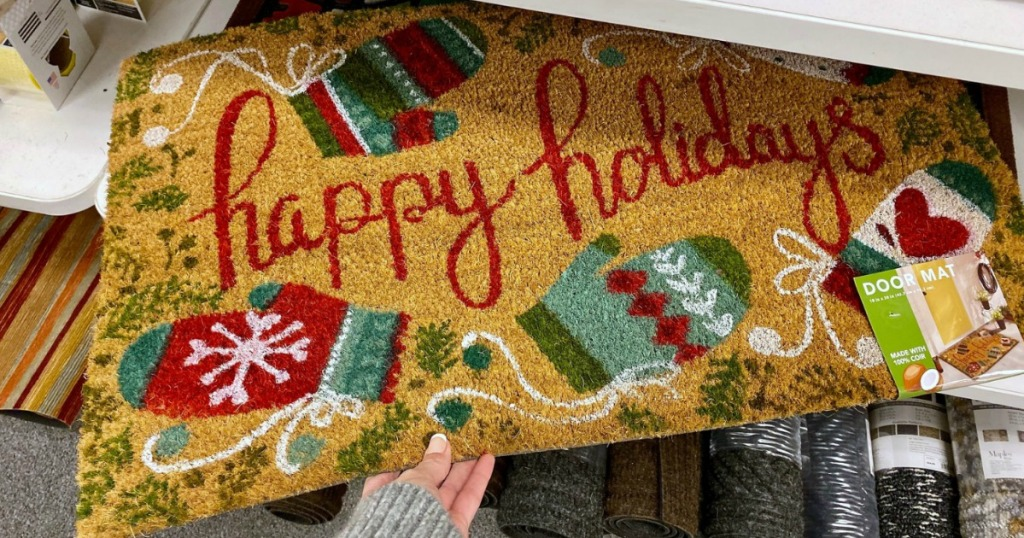"Mohawk ""Happy Holidays"" Christmas themed doormat in store on shelf"