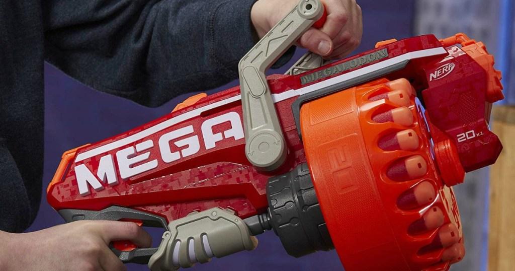 kid holding a NERF Megalodon N-Strike Mega Toy Blaster