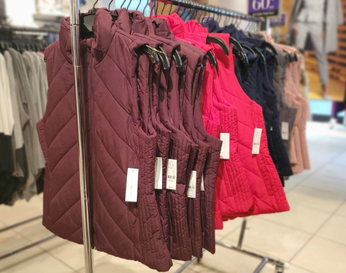 New York & Company Puffer Vests on rack in store in various colors