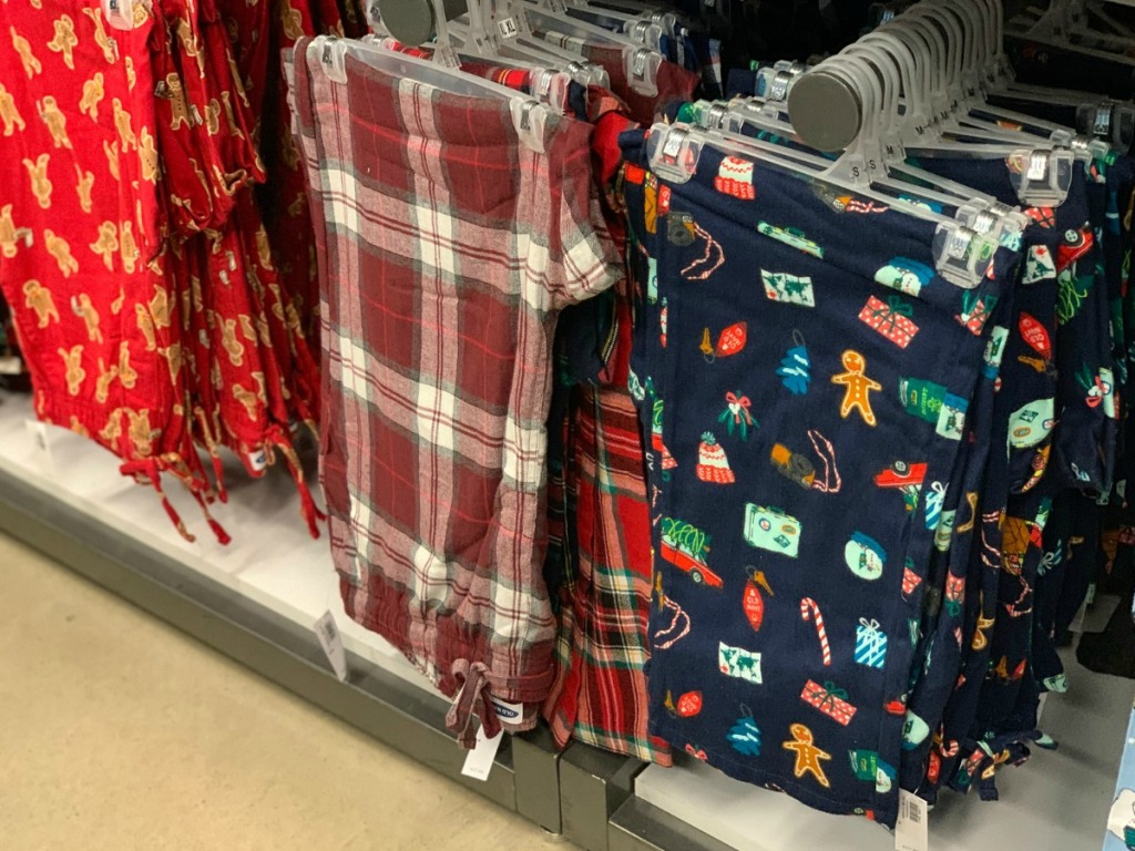 Styles of men's pajamas pants on hangers at Old Navy store