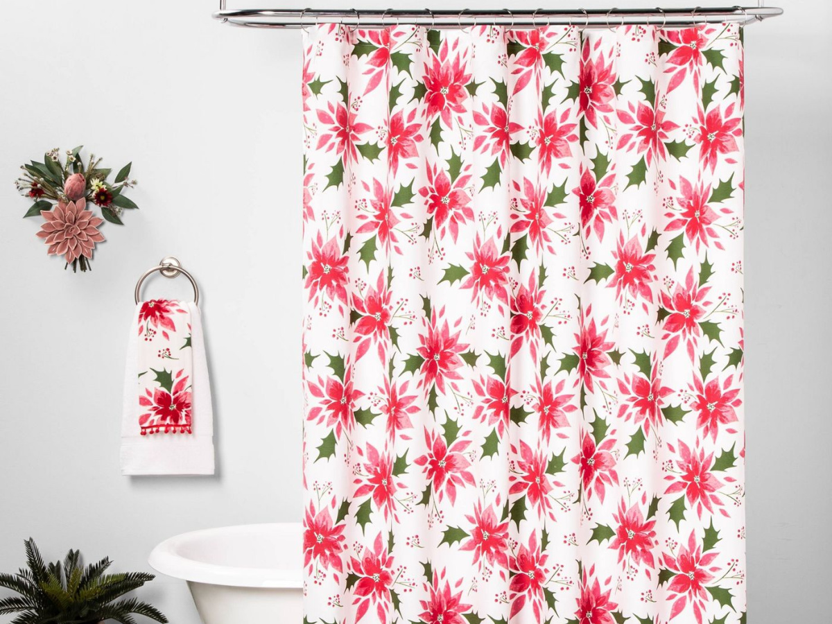 festive shower curtain in front of bathtub