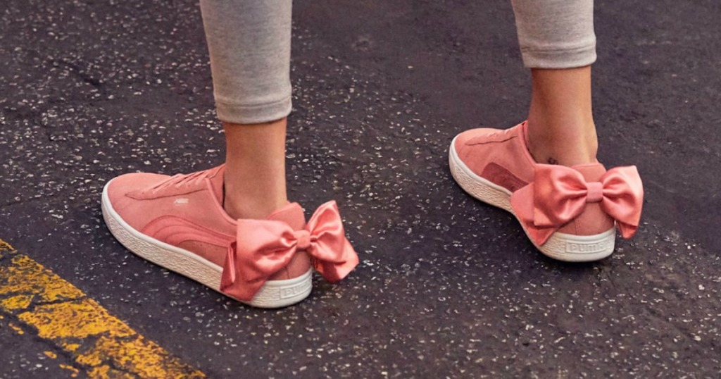 woman wearing PUMA Sneakers