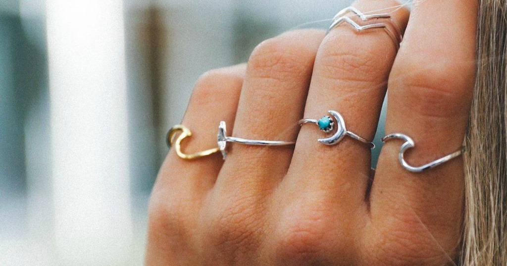 Girl wearing PURA Vida Wave Rings
