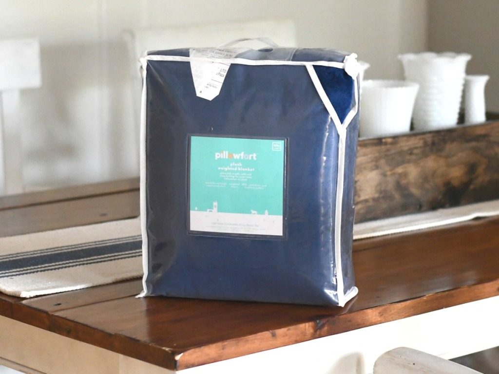 Pillowfort kids weighted blanket in blue in package on counter
