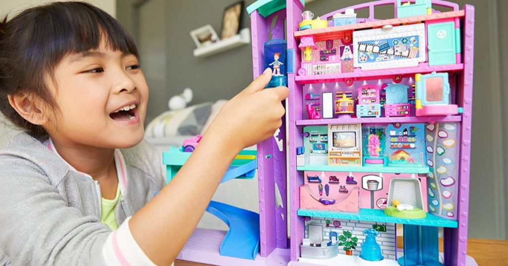 girl playing with Polly Pocket Mega Mall using elevator