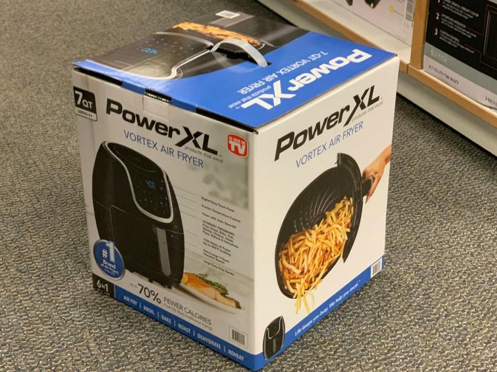 PowerXL Air Fryer in box on floor