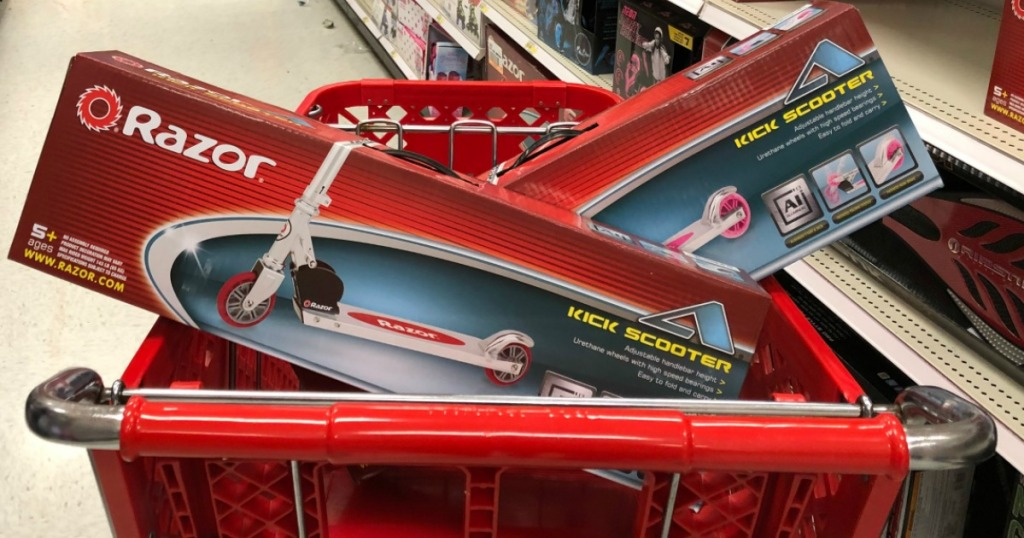 Razor Kick Scooters in red shopping cart in Target store aisle