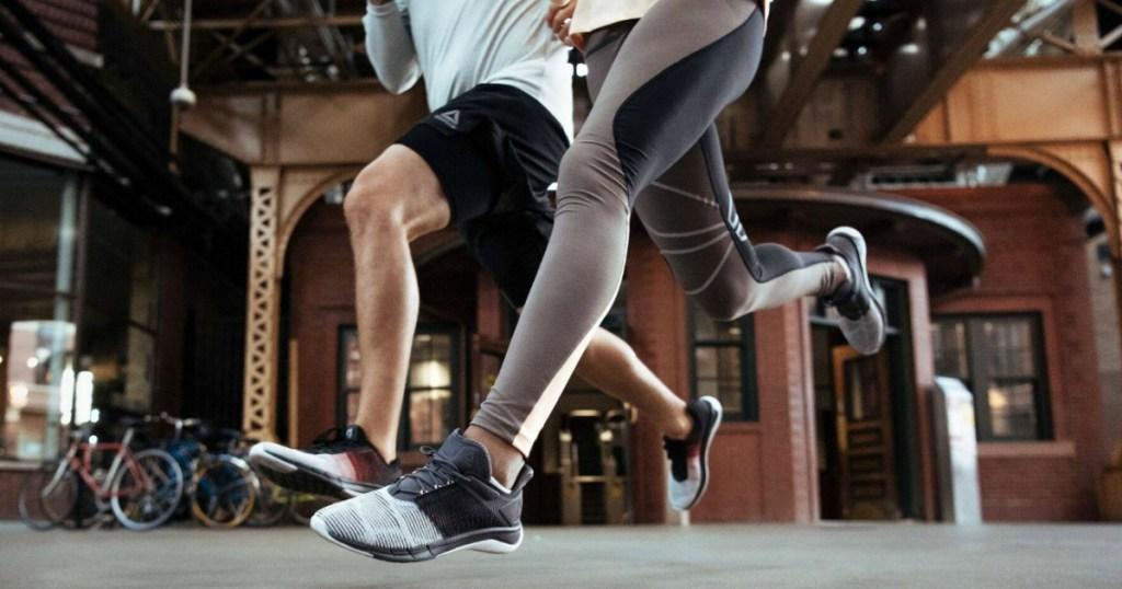 people running in reebok athletic apparel