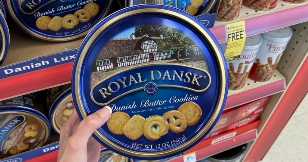 hand holding Royal Dansk Cookies in a store