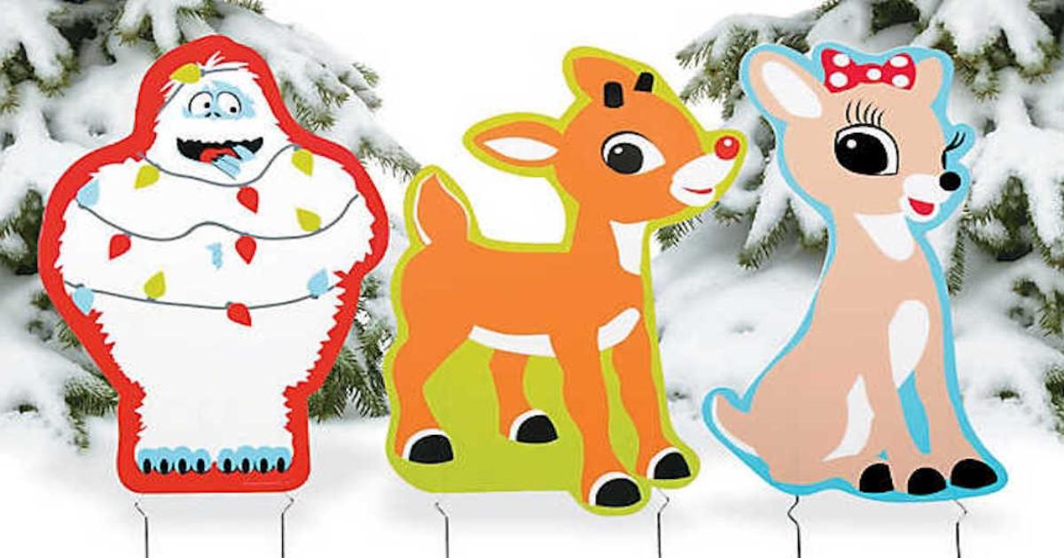 Rudolph Yard Signs in a snowy yard