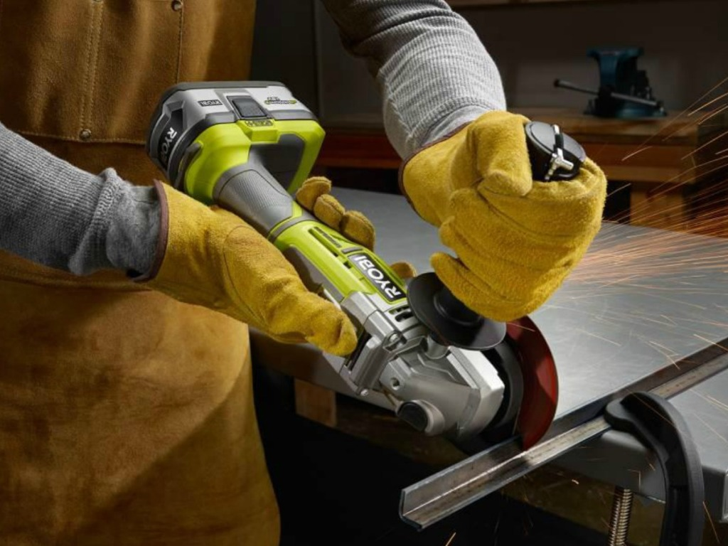 Man wearing work gloves and using Ryobi Angle Cutter