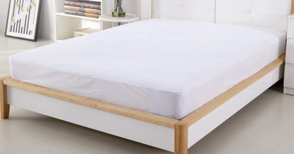 Sable mattress protector on bed