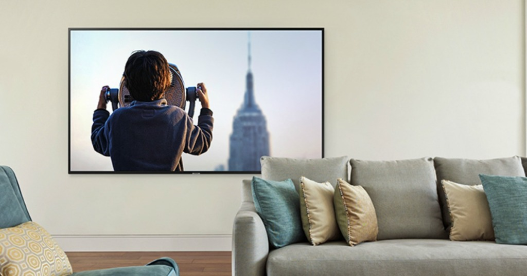 flat screen tv hung on living room wall