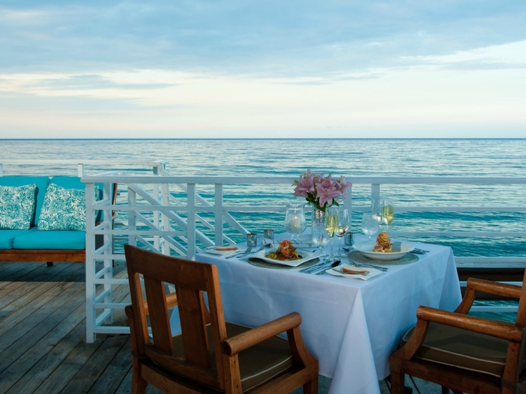 Sandals resort dining table at sunset