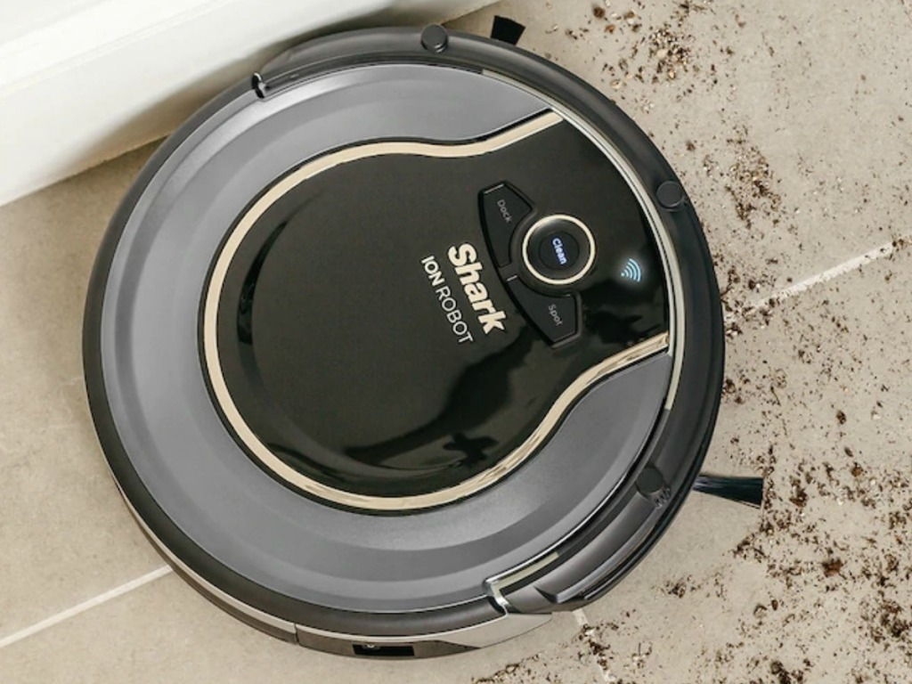 Shark ION Robotic Vacuum cleaning up dirt