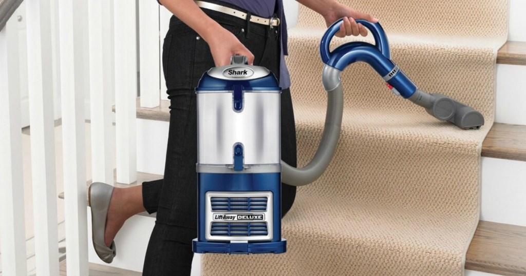 woman using a Shark Lift-Away Deluxe Vacuum