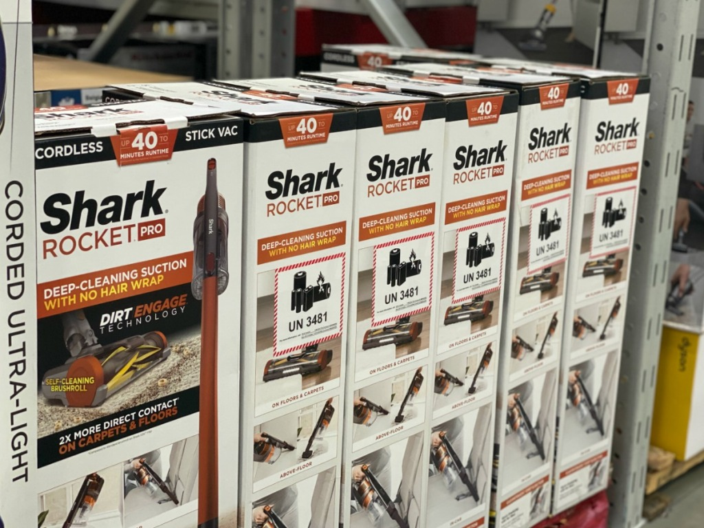 Store display of Shark Rocket Pro Cordless Stick Vacuums
