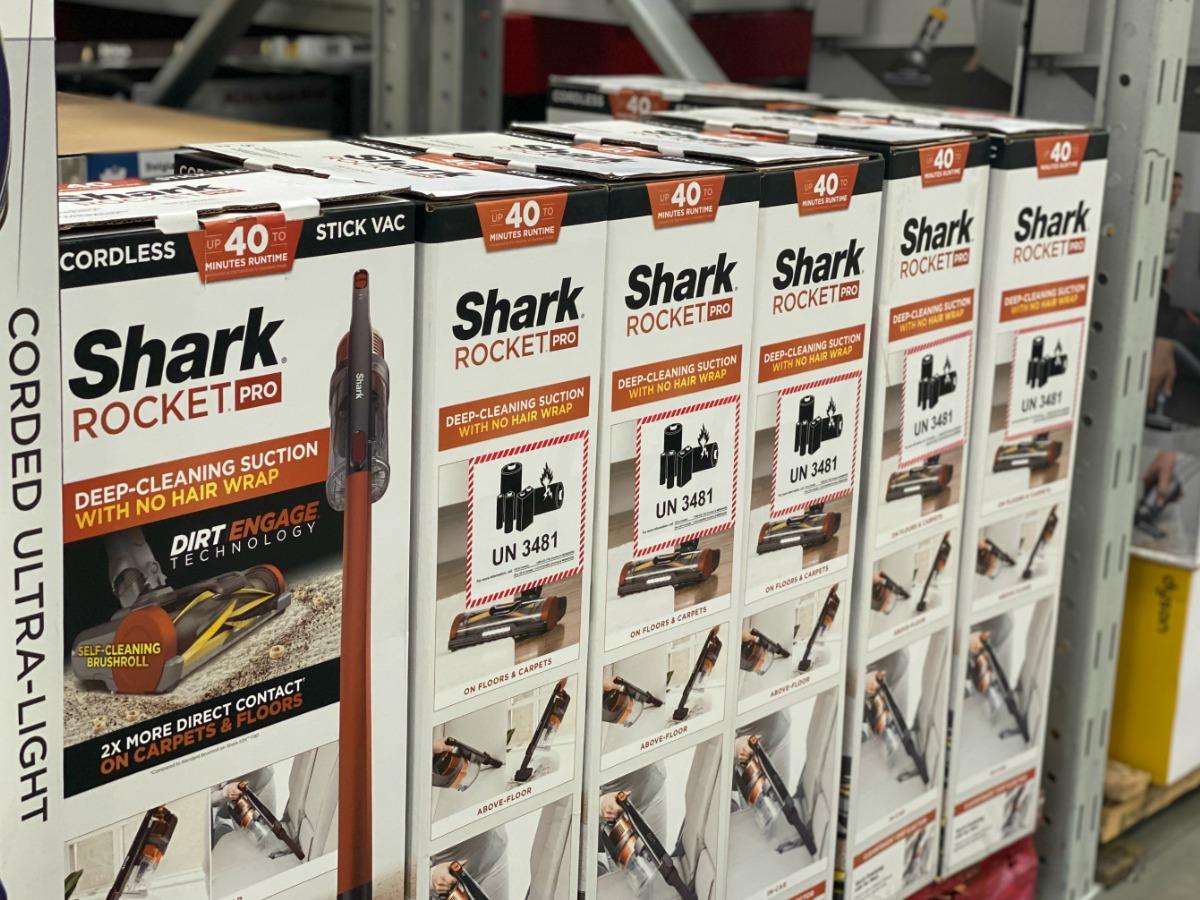 Store display of Shark Rocket Pro Cordless Stick Vacuums