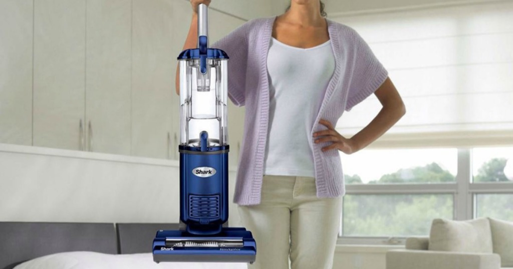 Woman holding a blue Shark Upright & Canister Upright Vacuum