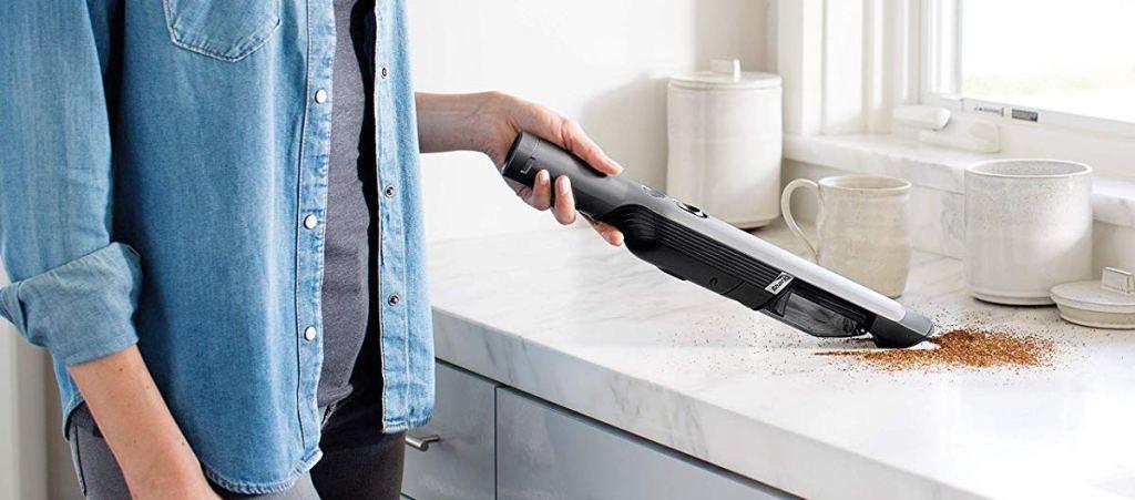 woman vacuuming counter