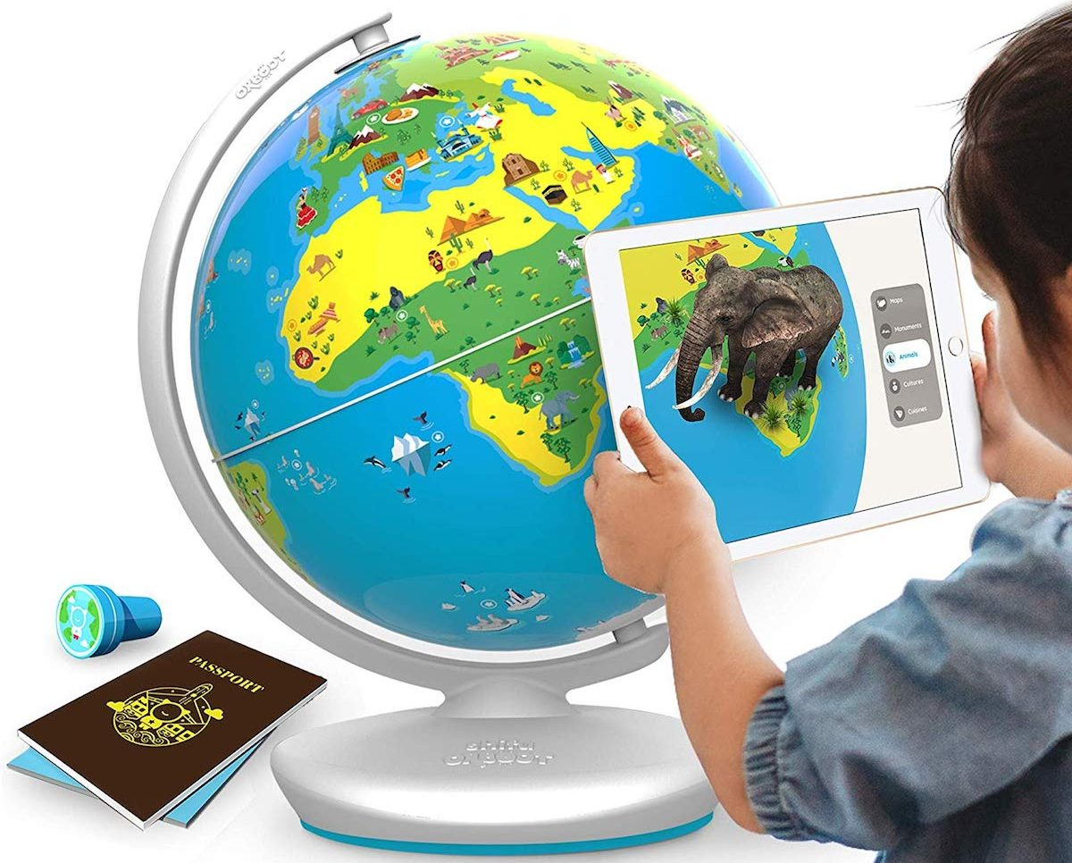child playing with interactive globe