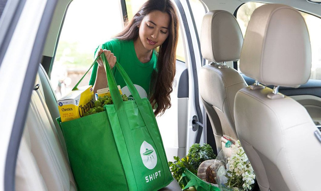 Shipt Shopper Placing Shopping Bags in a Car