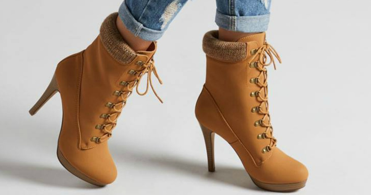 Woman wearing ShoeDazzle Boots