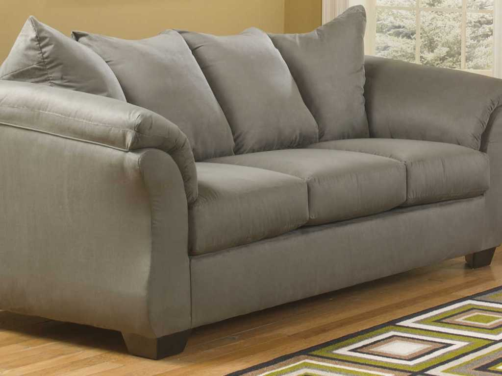 Signature Design by Ashley Audrey Fabric Pad-Arm Sofa in living room