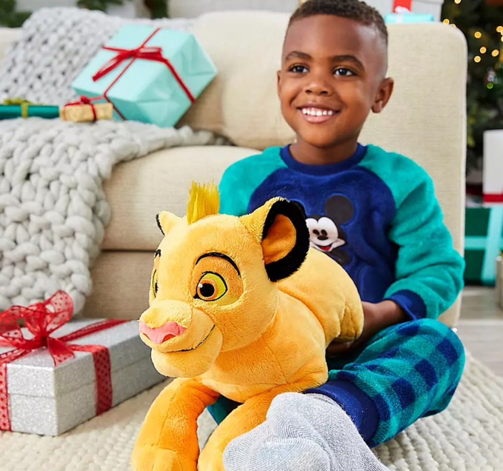 little boy holding Simba plush lion