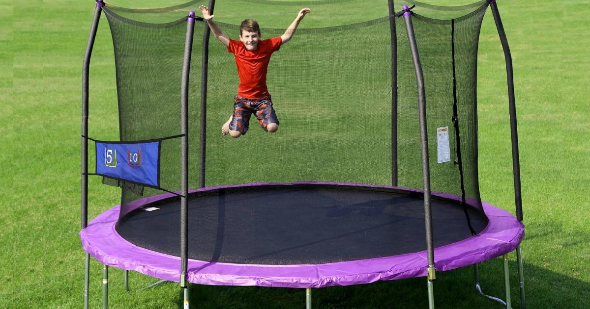 boy jumping on Skywalker Trampoline with net